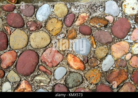 Rolling stones floor colorful pattern in Pyrenees Spain - Stock Photo