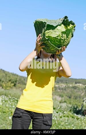 Girl and cabbage - Stock Photo
