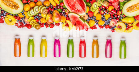 Variety of colorful smoothies and juices beverages in bottles with various fresh organic fruits and berries ingredients - Stock Photo