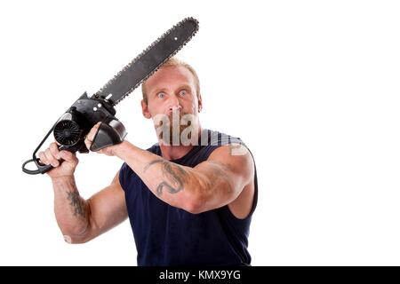 Crazy Caucasian man with tattoos and chainsaw above his head with strong expression in eyes, isolated - Stock Photo