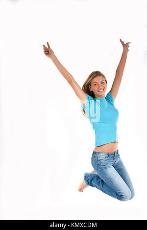 Beautiful young woman jumping with arms raised up, isolated on white - Stock Photo
