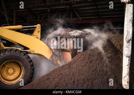 Industrial compost made from composted vegetables and animal manure in a farm. - Stock Photo