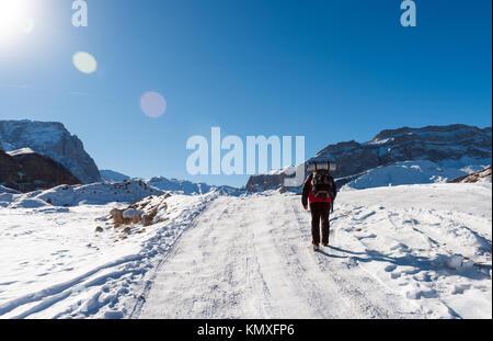 Tourist climber on a mountain snow trail - Stock Photo