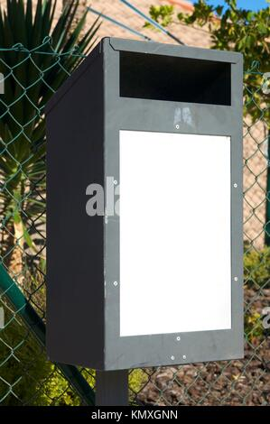 trash bin with white sign - Stock Photo