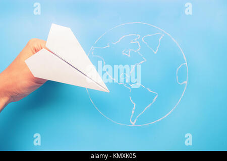 plane above world map. travel and tourism concept - Stock Photo