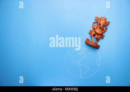 ganesha statuette on the earth. peace in the world concept - Stock Photo
