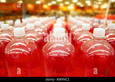 assembly line bottle red liquid rows lines perspective - Stock Photo