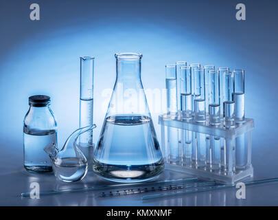 Different laboratory beakers and glassware. Monochrome. - Stock Photo