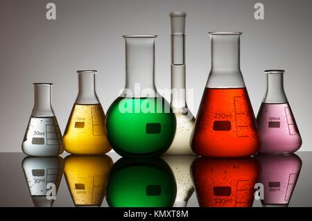 group of laboratory flasks containing liquid color - Stock Photo