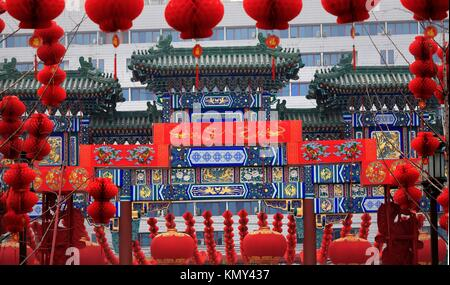 Ornate Chinese Gate Lucky Red Lanterns Chinese New Year Decorations Stone Gate Ditan Park Beijing China  During - Stock Photo