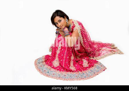 Beautiful Bangali bride in colorful dress sitting, isolated - Stock Photo