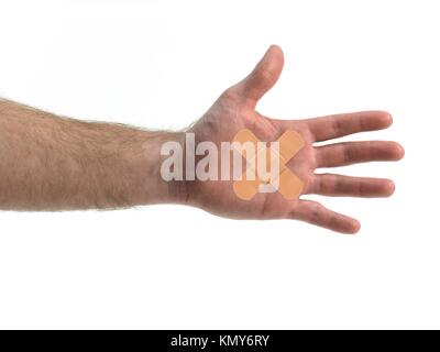 A hand isolated with a band aid against a white background - Stock Photo