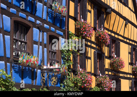Picturesque maisons à colombages (half timbered houses) in Riquewihr, a popular tourist destination on the Route - Stock Photo