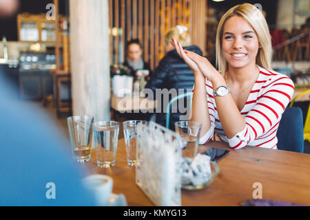 Beautiful woman resting in cafe - Stock Photo