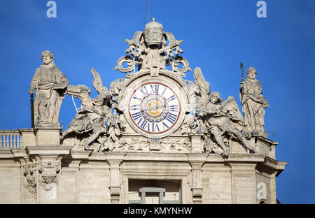 Maderno's facade with the clock between two statues, St. Peter's Basilica. Vatican City, Rome, Italy - Stock Photo