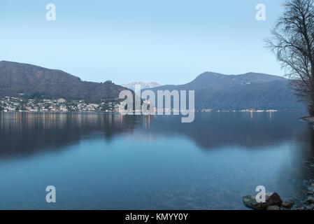 Lake Lugano between Ponte Tresa and Porto Ceresio Italy. View towards the Switzerland, Morcote village, Monte San - Stock Photo