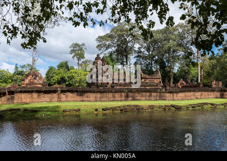 A side view of Banteay Srei temple and the moat around the complex, near Siem Reap, Cambodia. - Stock Photo