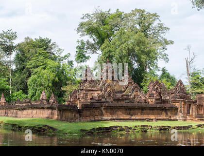 A view of Banteay Srei temple and the moat around the complex, near Siem Reap, Cambodia. - Stock Photo