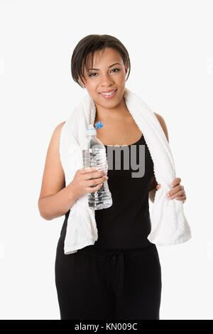 Beautiful attractive happy young sweaty woman with water after exercise workout, rehydrating thirst quenching, isolated - Stock Photo