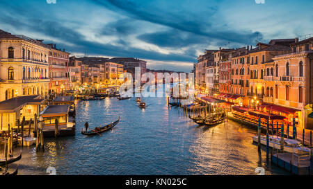 Grand Canal at night with a gondola, Venice, Italy - Stock Photo