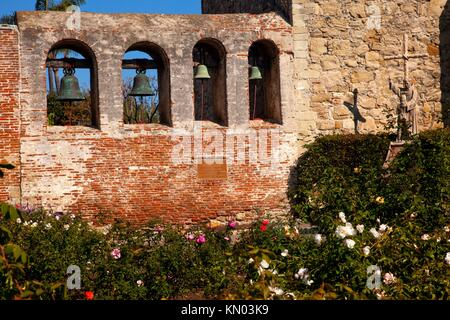 Mission San Juan Capistrano Church Rose Garden, Wall, Bells and Ruins in California  The statue of Father Junipero - Stock Photo