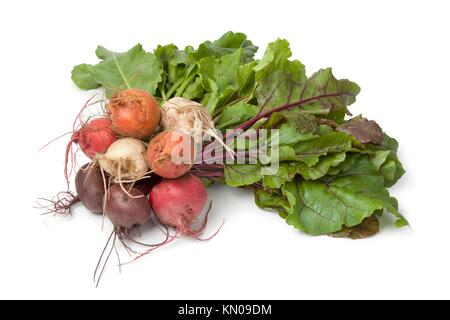 Bunch of fresh mixed color beets on white background - Stock Photo