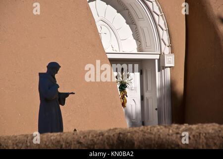 The silouette of a statue of St  Francis at a church in Taos, New Mexicon - Stock Photo