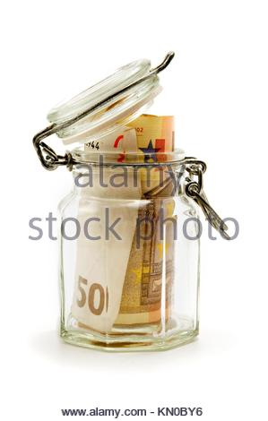 Jar filled with paper money on a white background - Stock Photo