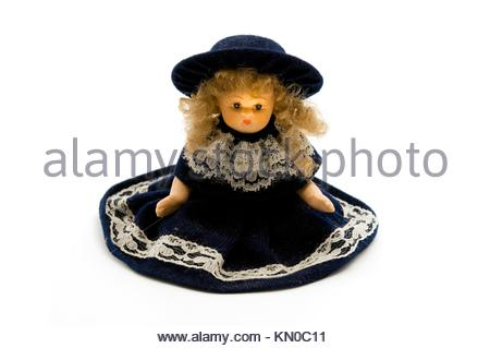 Old porcelain doll on a white background - Stock Photo