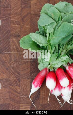 A bunch of radishes on a wooden backgroung - Stock Photo