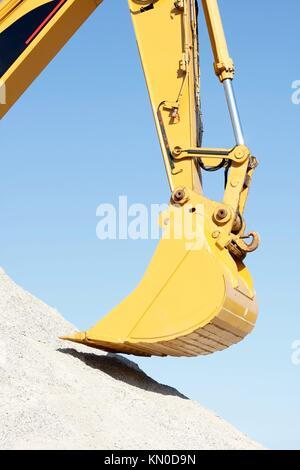 A huge shovel digging in dirt - Stock Photo