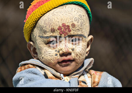 little child with traditional make up, Mandalay, Myanmar, Asia - Stock Photo