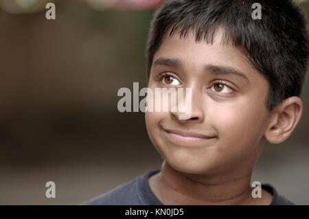 Young Indian boy day dreaming - Stock Photo