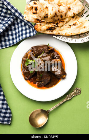 lamb shank or mutton or gosht paya or khoor curry served with indian bread or roti or naan - Stock Photo
