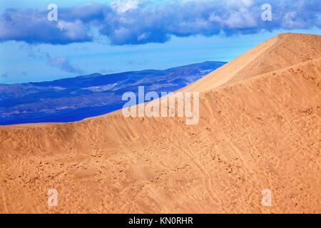 Large Sand Dune Mesquite Flat Dunes Grapevine Mountains Death Valley National Park California Ridge Line - Stock Photo