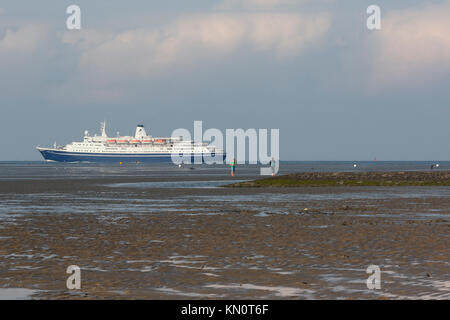 The cruise ship Marco Polo enters The North Sea from the Elb - Stock Photo
