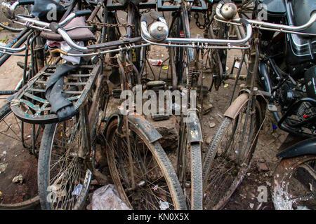 Abandoned Bycicles on street, Delhi, India - Stock Photo