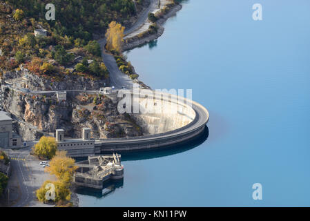 Aerial View over the Dam or Barrage on Lake Castillon, Used to Generate Hydro-Electric Power, near Castellane, Provence - Stock Photo