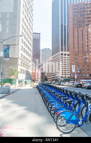 NEW YORK - JUL 10: Citi bike station in Manhattan on July 10, 2015. NYC bike share system started in Manhattan and - Stock Photo