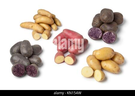 Variety of heirloom gourmet potatoes on white background - Stock Photo