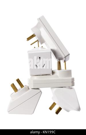 Stack of Power Adaptors on White Background - Stock Photo