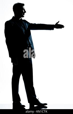 one caucasian man handshake profile full length silhouette in studio isolated white background - Stock Photo