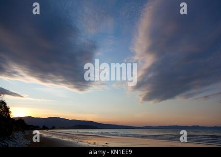 Sunset on the beach of Marlborough Sounds New Zealand - Stock Photo