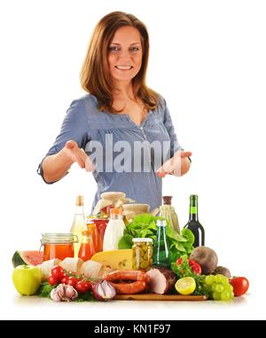 Young woman with variety of grocery products isolated on white. - Stock Photo