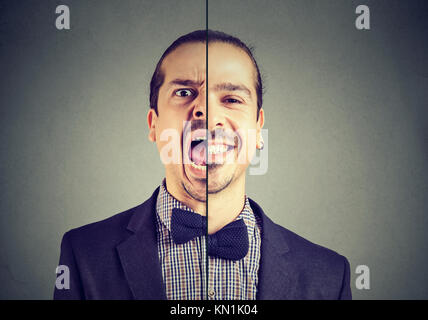Bipolar disorder concept. Young business man with double face expression isolated on gray background - Stock Photo
