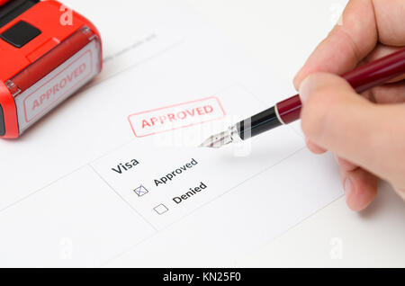 Visa and approved stamp on a document form. Immigration and travel concept - Stock Photo