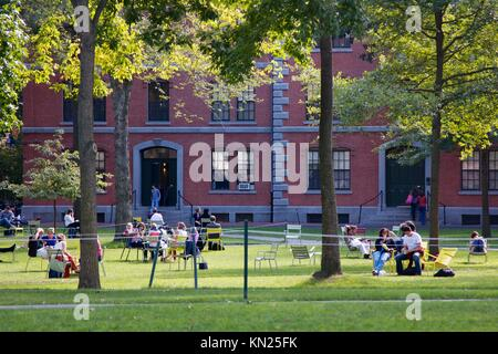 Cambridge, MA, USA - September 27, 2012: Students and tourists rest in lawn chairs in Harvard Yard, the old heart - Stock Photo