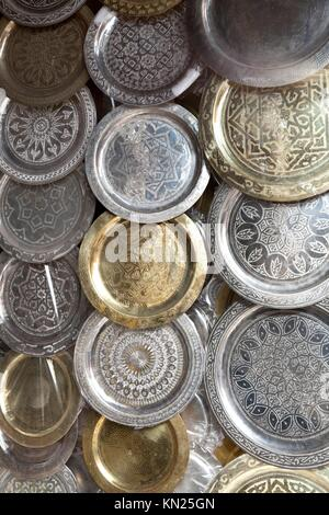 Moroccon metal trays for sale in the souk of Marrakesh, Morocco - Stock Photo