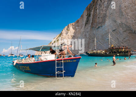 ZAKYNTHOS, GREECE, September 27, 2017: Tourists visit the famous Navagio Shipwreck beach in Zakynthos island Greece. - Stock Photo