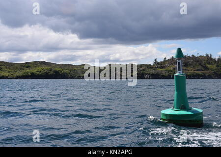 Approaching Stornoway, in cruise ship tender with navigation bouy - Stock Photo